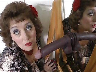 Simmering mature woman plays with black fake cock