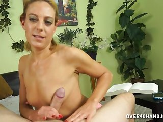 Mature amateur Charly Shay strokes a dick and gives a titjob