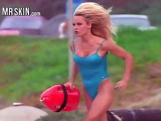 Busty cosset Pamela Anderson running in the brush iconic red Baywatch swimsuit