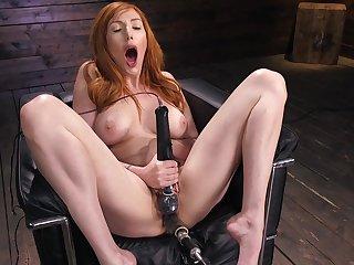 Redhead pornstar Lauren Phillips pleasures her pussy roughly a vibrator