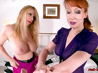 Red XXX and Lucy Gresty share a facsimile sided dildo