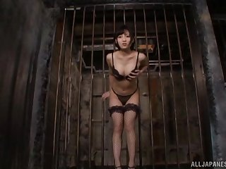 Kinky Japanese infant in fishnet stockings moans while riding a toy